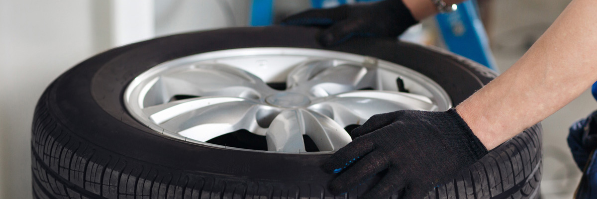 Mechanic holding a car tyre - Sutton Coldfield